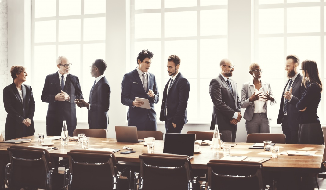 Businesspeople chatting in a boardroom